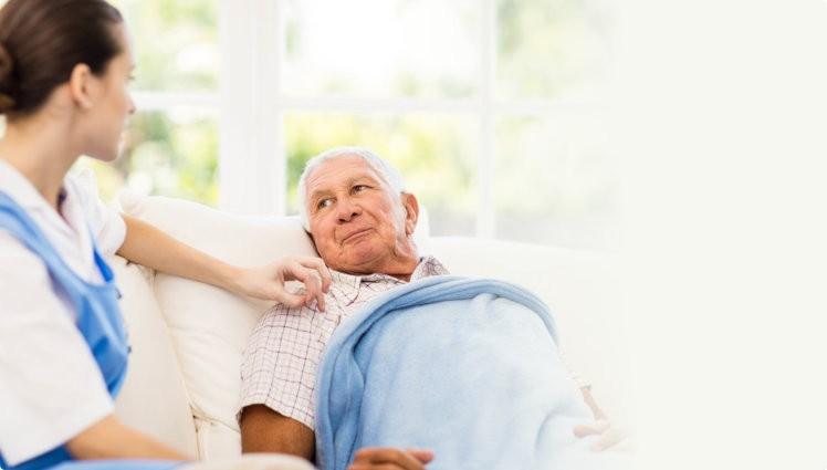 Nurse taking care of sick senior patient