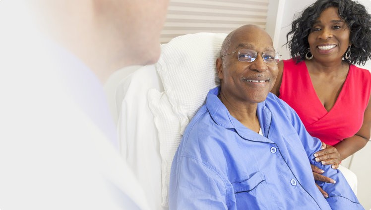 Senior patient with his wife