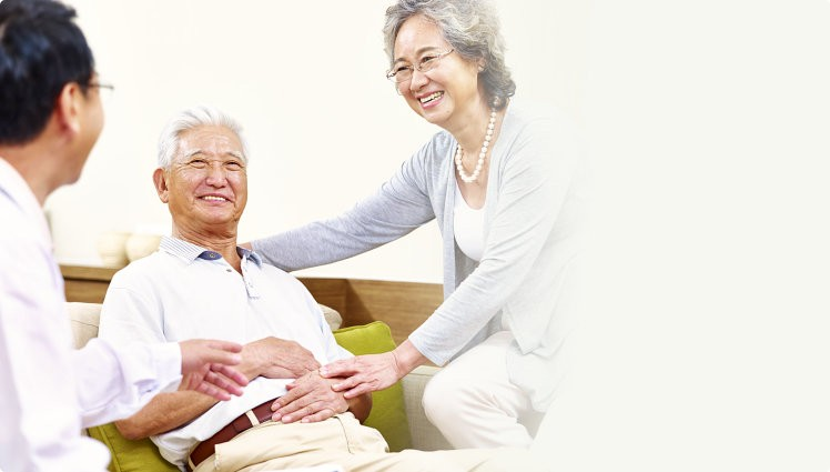 Senior patient being taken care of by his wife